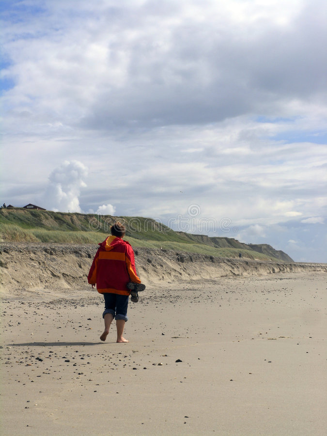 海滩含沙妇女 库存照片