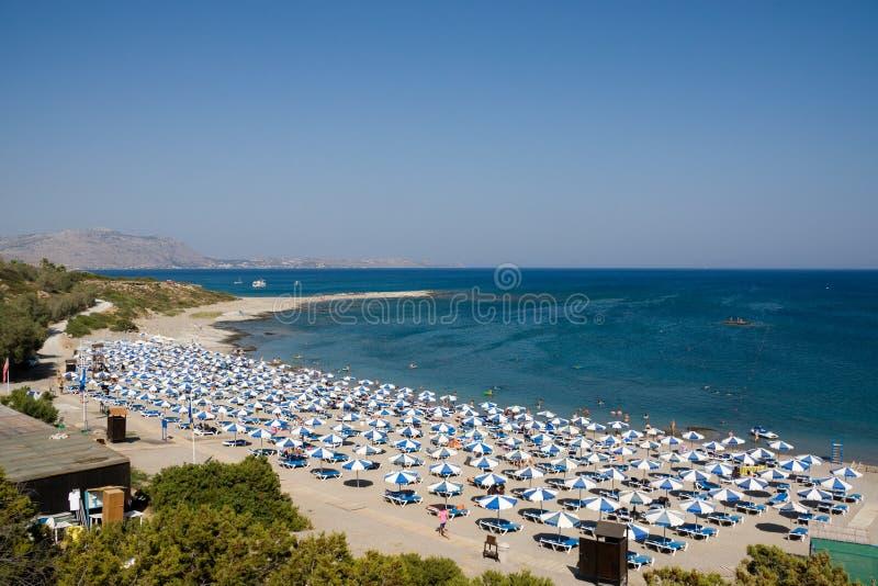 海滩抽签遮阳伞手段 免版税库存图片