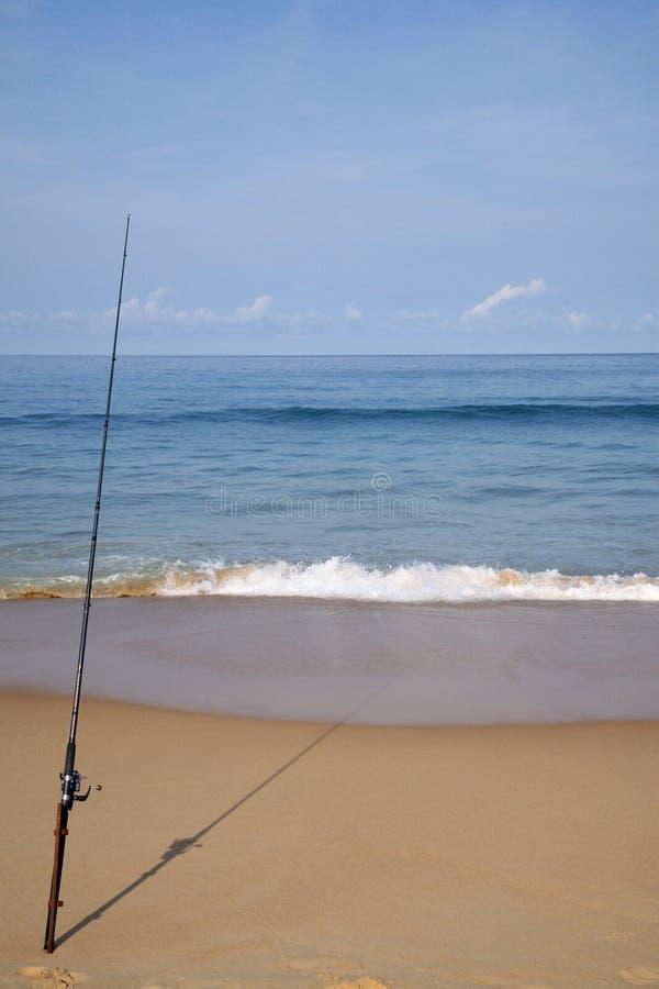 海滩捕鱼 免版税库存图片