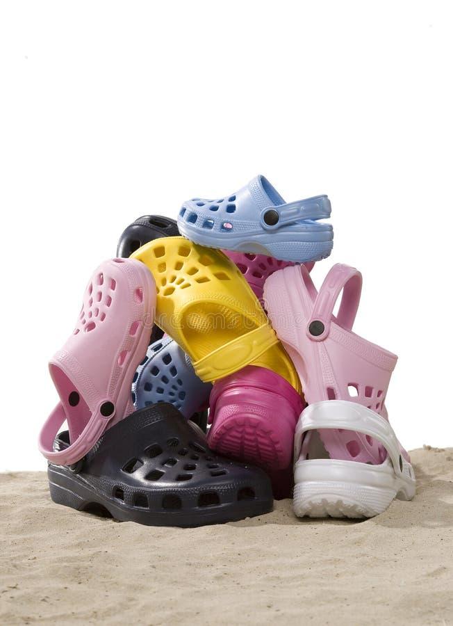 海滩沙子鞋子 免版税图库摄影