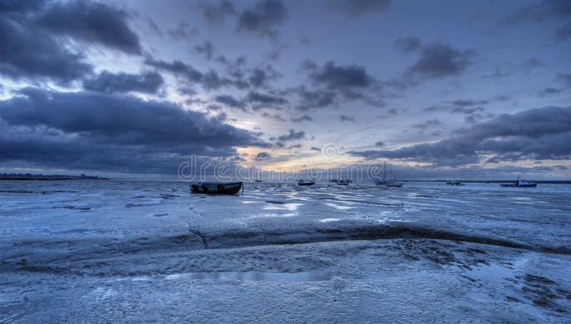 海滩泥泞的日出 库存图片