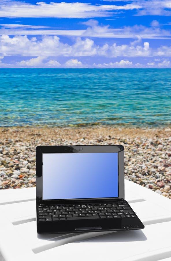 海滩笔记本 库存图片