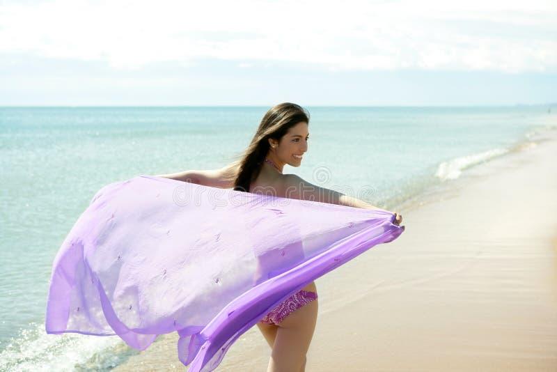 海滩美丽的比基尼泳装连续妇女 免版税库存图片