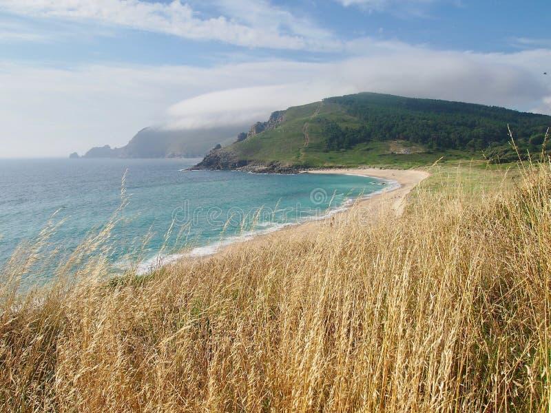 海滩菲尼斯特雷角-卡米诺de圣地亚哥西班牙的真正的结尾 库存照片