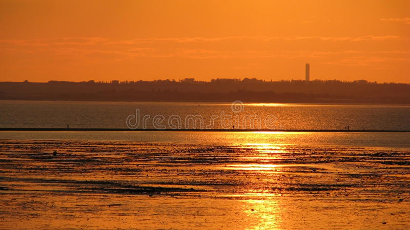 海滩行业地平线日落 库存图片
