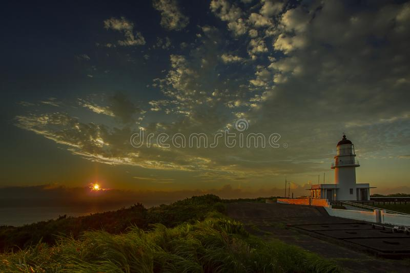 海角在日落的圣地亚哥灯塔 库存图片