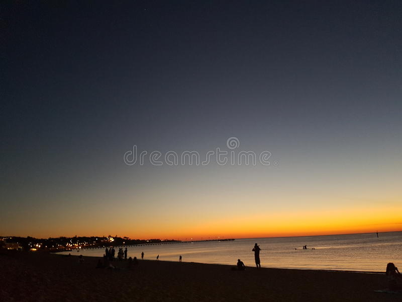 海滩在海滩的海洋海滨日落 库存图片