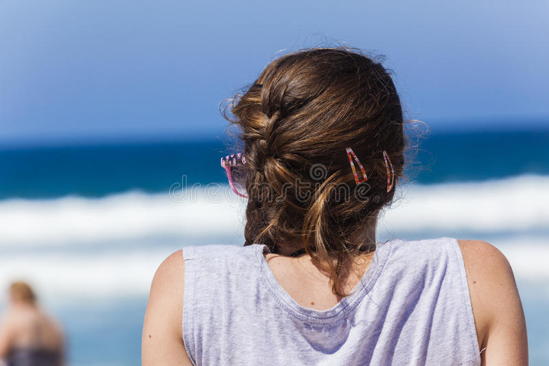 海滩女孩少年 免版税库存图片