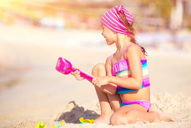海滩女孩愉快使用 库存照片