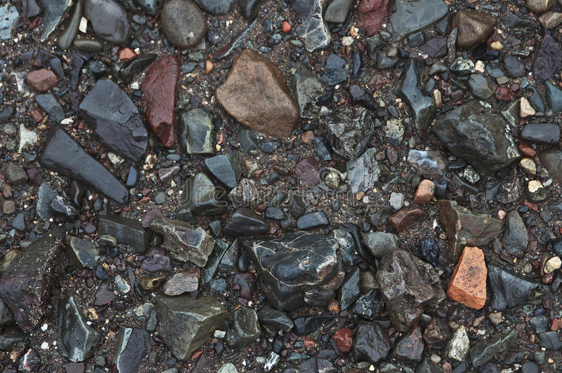 海滩当前石头 免版税库存图片