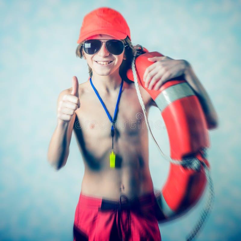 海滩救生员男孩 免版税库存图片
