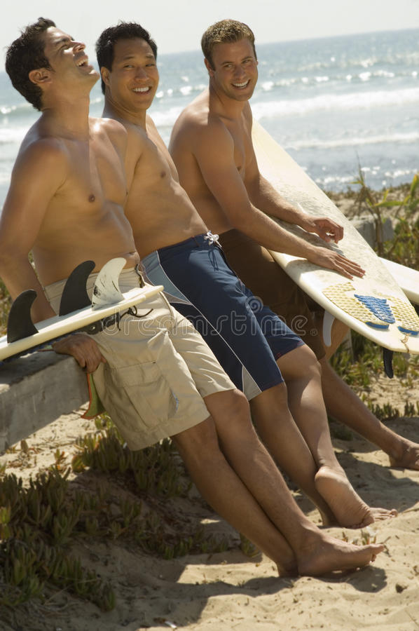 海滩的男性朋友 图库摄影
