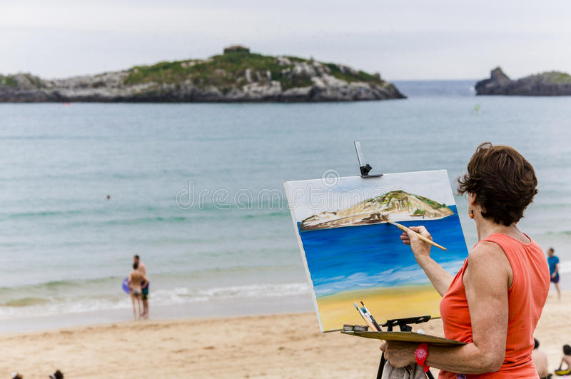 海滩的画家 库存照片