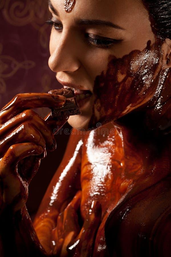 涂了巧克力的熔化妇女 库存图片