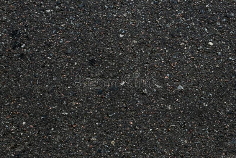涂柏油织地不很细背景 黑暗的沥青表面纹理 黑背景抽象特写镜头  石头,石渣backgroun的样式 库存图片