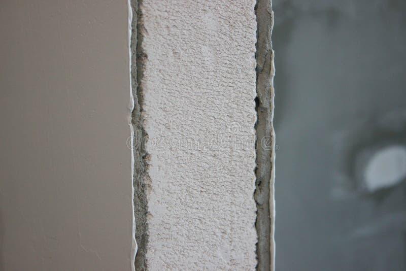 涂灰泥和涂灰泥的气体块墙壁 墙壁的准备完成的 修理和建筑 免版税库存图片