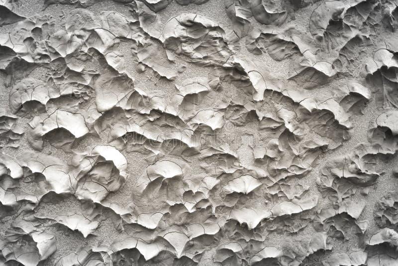 涂灰泥在无缝的概略的压印的样式纹理摘要的灰色水泥墙壁背景的 免版税库存图片