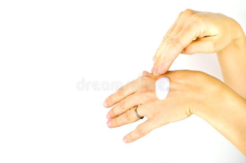涂白色奶油破裂的手 免版税库存图片