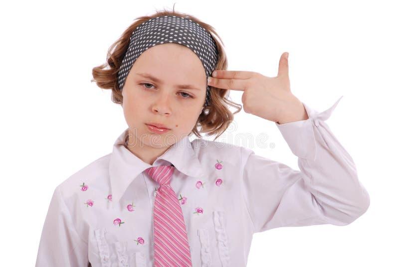 消沉的女孩握一只手在头作为手枪 免版税库存照片