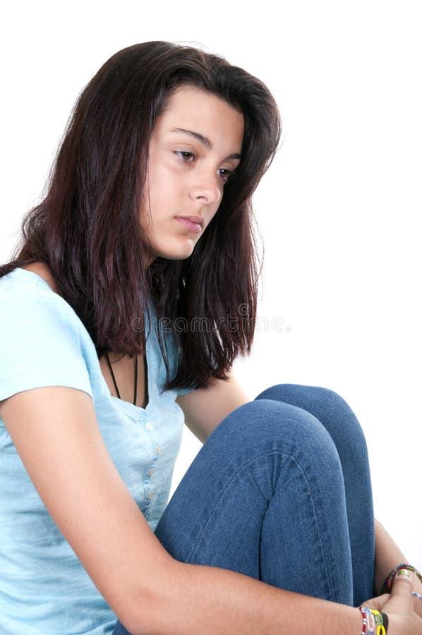 消沉青少年的女孩哭泣孤独 免版税库存照片