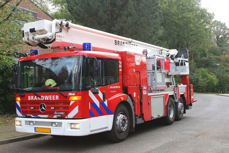 消防车在风暴,荷兰期间是候补 免版税库存照片