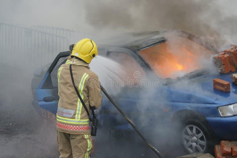 消防队员,汽车火 免版税库存图片