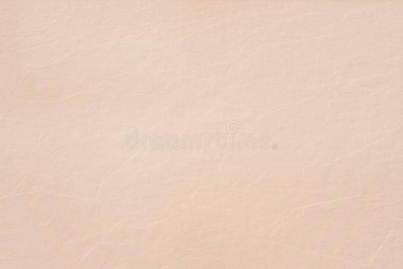 淡桔色的水彩纸纹理背景 免版税库存图片