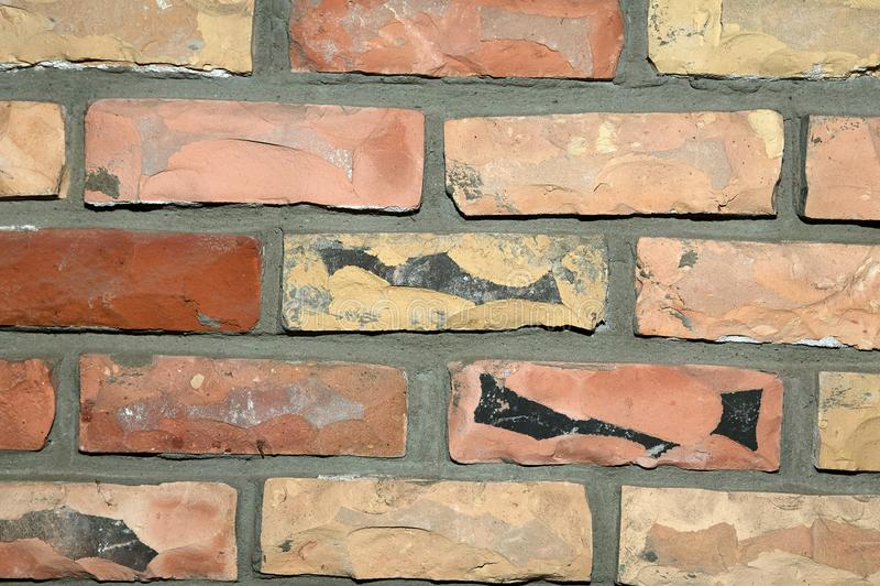 淡桔色的面砖墙壁背景纹理 免版税库存照片