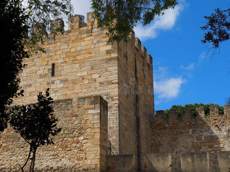 淡色的砖城堡墙壁  库存图片