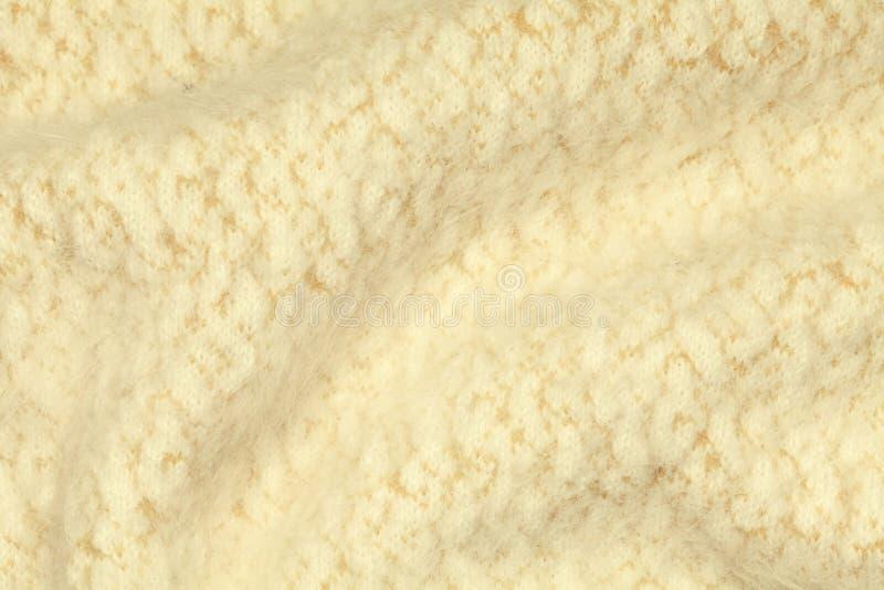 淡黄色被弄皱的豪华开士米背景 库存照片