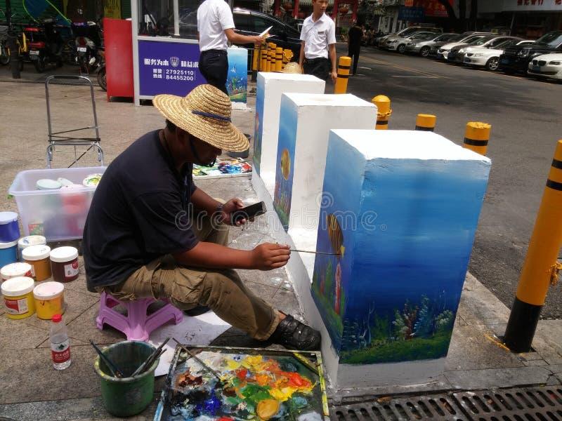 深圳,中国:绘画的街道艺术家,装饰街道 免版税库存图片