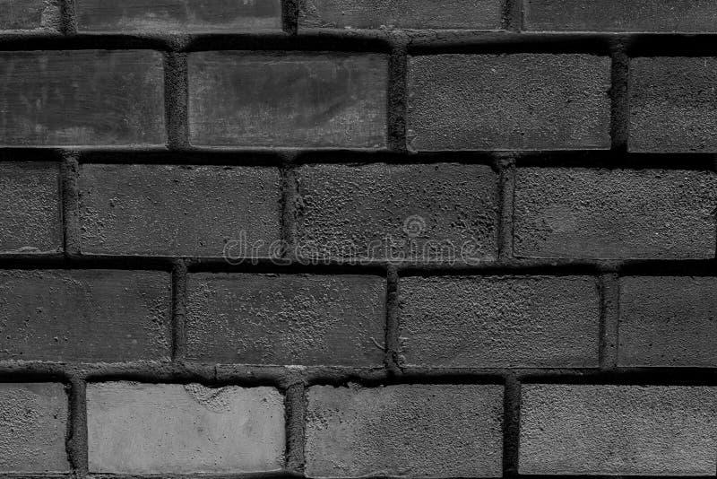深灰与水泥缝multichrome基本的设计顶楼的乌贼属背景砖对称行长方形石头 免版税库存图片