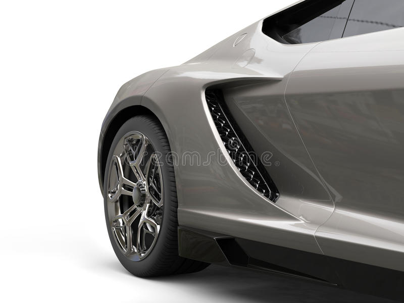 深灰现代体育车的后轮特写镜头 免版税图库摄影