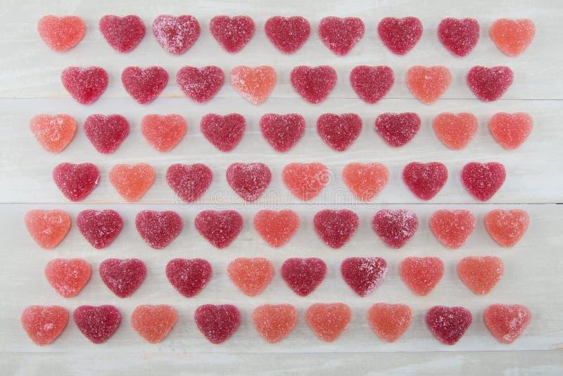 深红和桃红色胶粘的心脏宽看法栅格  免版税图库摄影