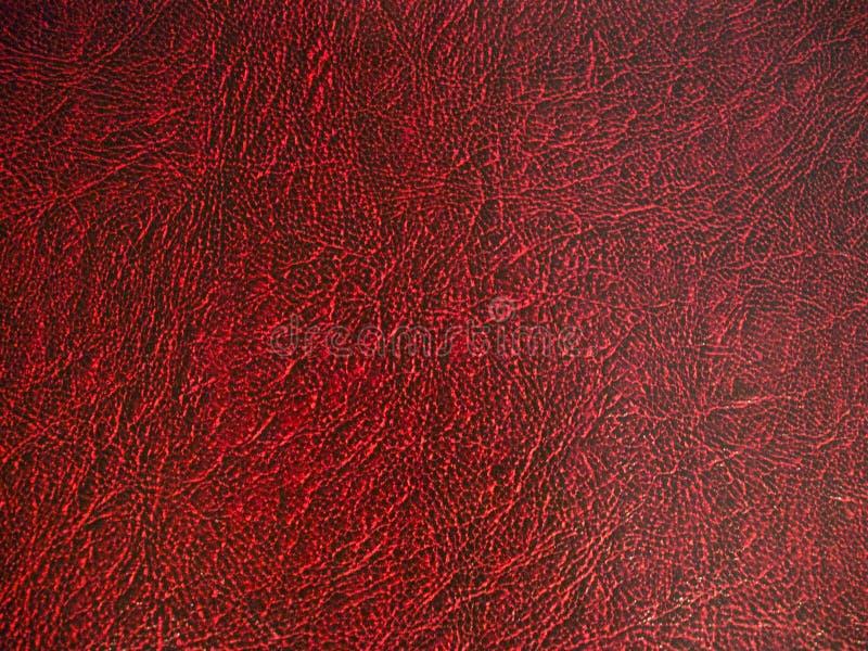 深红皮革背景纹理 免版税库存照片