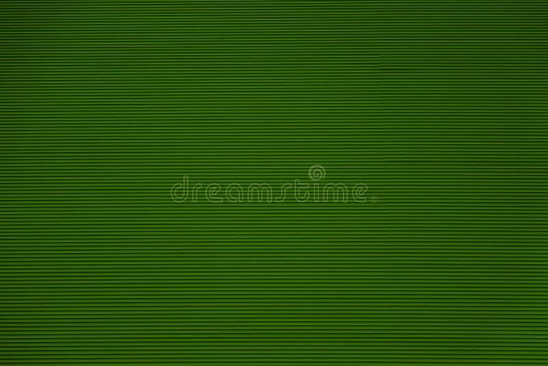 深绿颜色波纹状或概略的波浪织地不很细背景  免版税库存图片
