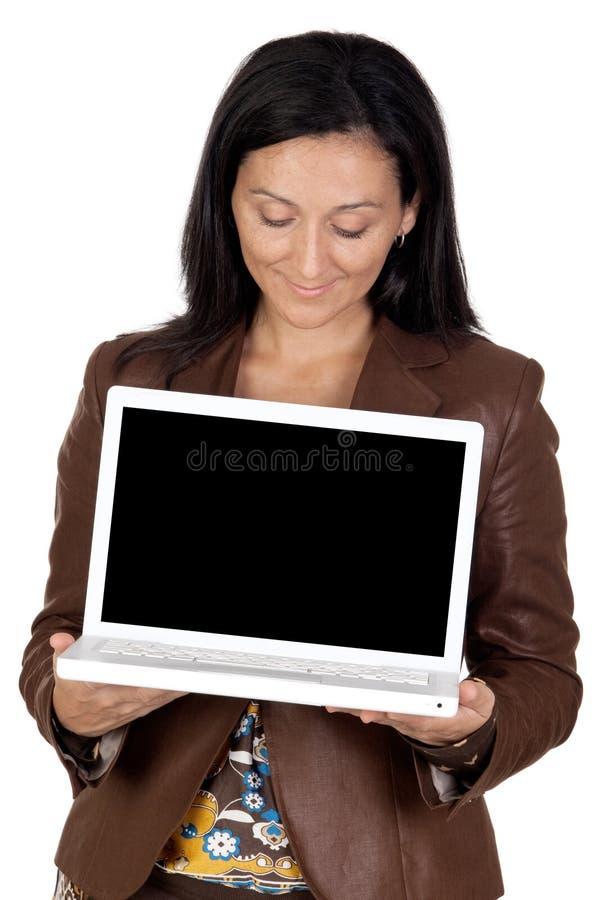 深色的女孩膝上型计算机 免版税库存照片