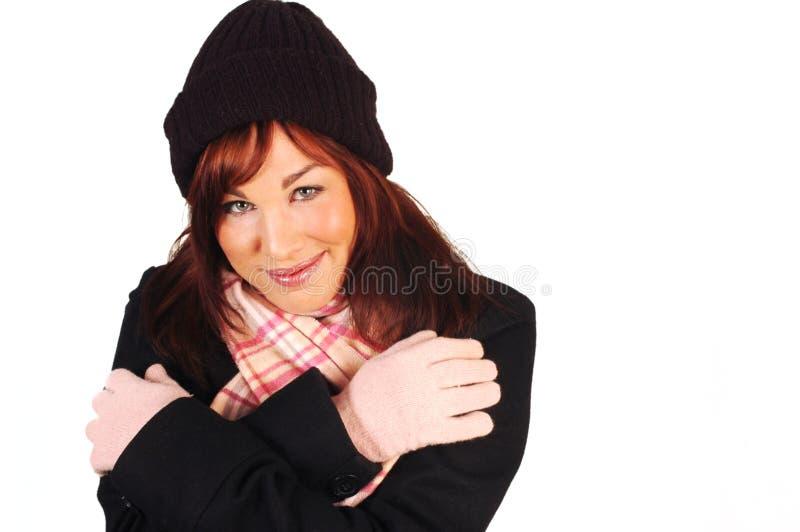 深色的衣裳微笑的冬天 免版税图库摄影