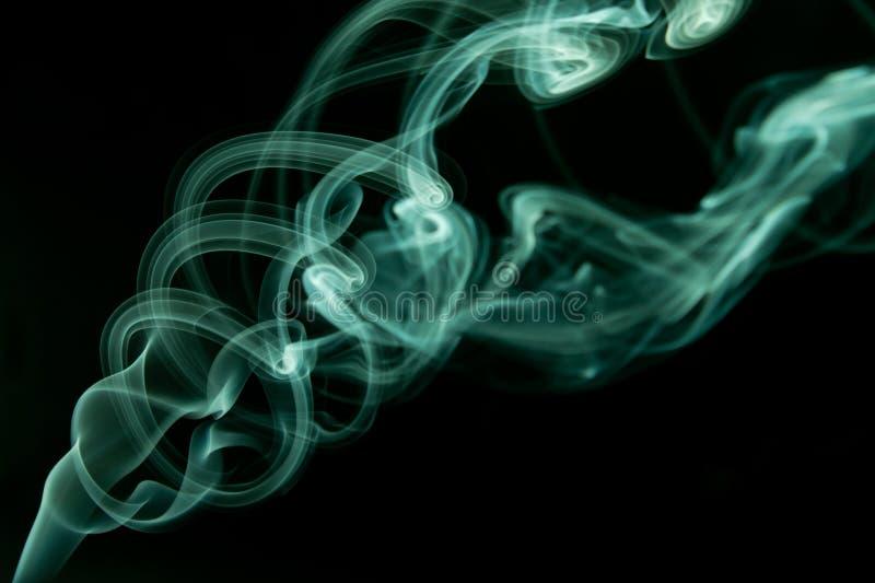 深蓝烟摘要 库存照片