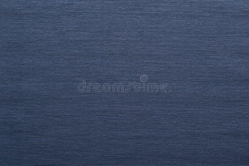 深蓝织品背景或纹理 免版税图库摄影