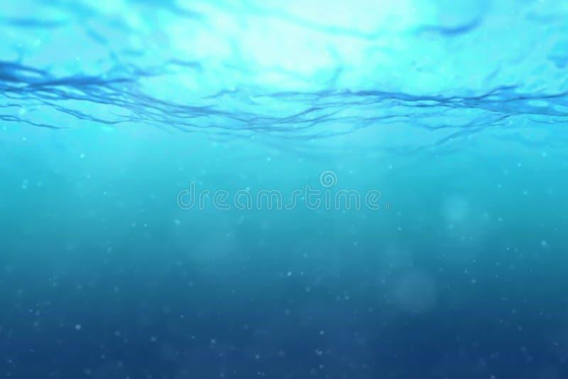 深蓝色海浪优质完全无缝的圈从水下的背景的与微微粒流动 免版税图库摄影