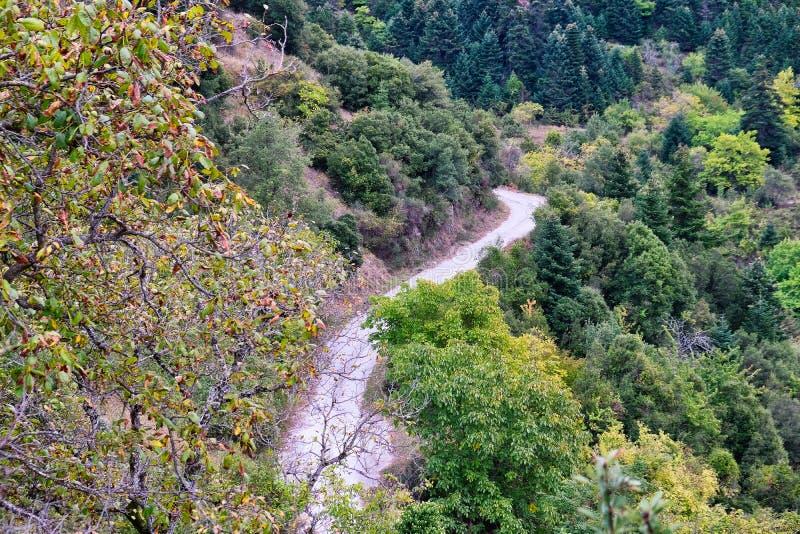 混凝土被密封的希腊山路 免版税库存照片