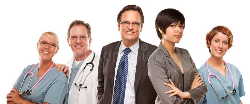 混合的族种妇女和商人与医生或护士 库存照片