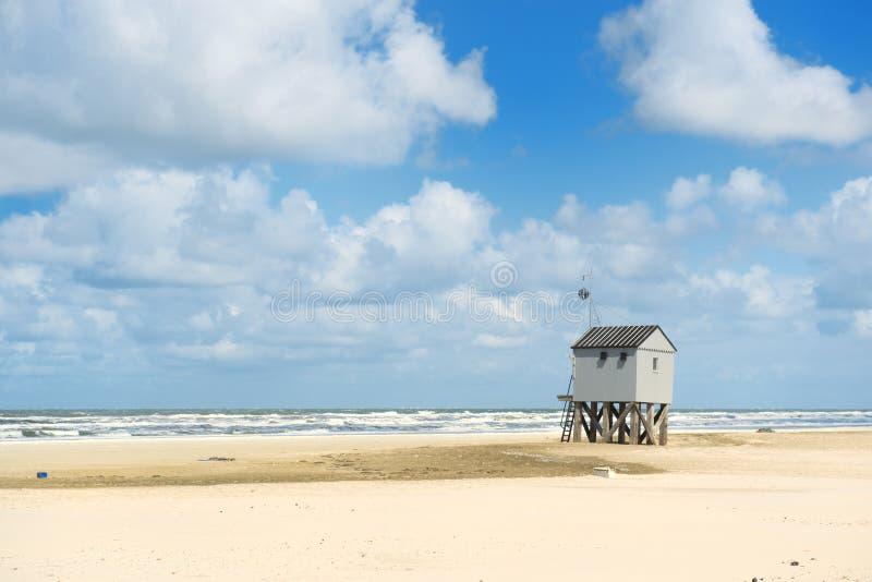 淹没海滩的房子 库存照片
