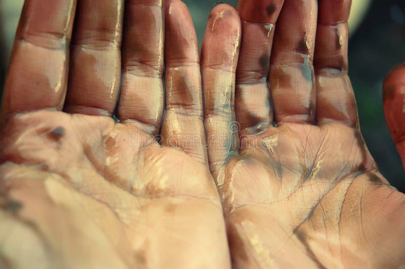 清洁海岸递漏油工作者 库存照片