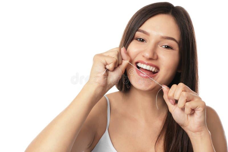 清洁牙齿她的在白色背景的年轻女人牙 库存照片