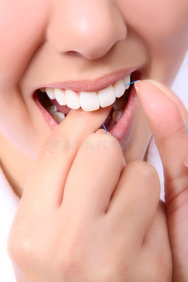 清洁牙齿她的牙妇女 免版税库存图片