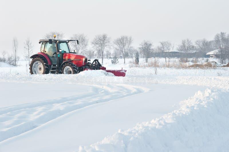 清洁雪拖拉机 免版税库存照片