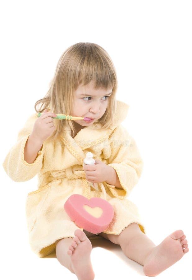 清洗女孩小的牙 库存照片
