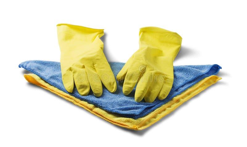 清洗的海绵,旧布餐巾,在白色的橡胶手套隔绝了白色背景 清洗的房子项目 hygie想法  图库摄影
